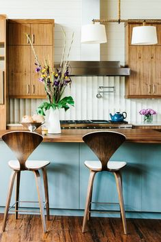 Color in the kitchen-love the pop of blue in the island with all the natural wood. Designer unknown