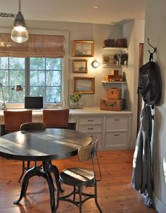 White Furniture, gold frames, warm wood colored accents.  Rustic office with burlap roman shade, desk for two & table