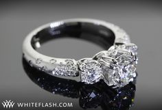 I also like the 3 stoned rings with diamond crystals on the side