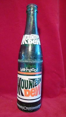 mountain dew 60s bottle- I LOOOOOOOOOOOVED bottles like this in the 70's- I could bearly drink an entire bottle down!