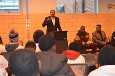 Former NFL player Calvin Hill speaks to youth at Chick Webb Recreation Center during outreach event with the Ed Block Courage Award Foundation
