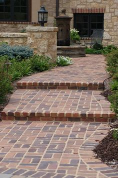 Reclaimed brick patio, steps, and walkway. #TopekaLandscape