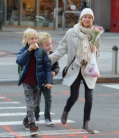 School run! British-born, Australian-raised actress Napomi Watts looked chic on Monday when she was spotted in trendy Soho, New York, with her two boysSamuel and Sasha