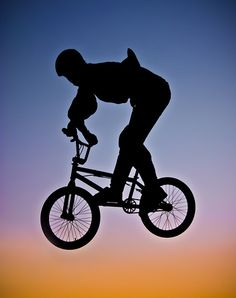 Stunt cyclist ~ silhouette by Mark Chandler Photography.