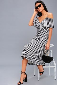 Lulus Exclusive! Life's a day at the beach in the Avila Black and White Gingham Midi Dress! Lightweight woven fabric, in an adorable black and white gingham print, creates adjustable spaghetti straps, off-the-shoulder sleeves, and a ruffled surplice bodice. Fitted waist and full midi skirt with side seam pockets. Hidden back zipper.