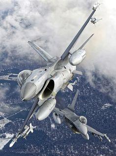 Two Belgian air force F-16s perform a split maneuver over Belgium. Photo:  Benoit Denet, Rixensart, Belgium