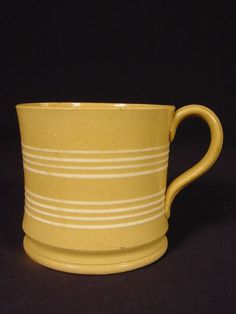 This is a very attractive mug dating to the The mug is decorated with 2 pair of 4 nicely formed brilliant white bands. The mug is molded with a finely formed raised foot and applied strap handle. Yellow Bowls, Stoneware Crocks, Antique Pottery, Sgraffito, Mocha, Ceramics, Mugs, Antiques, Tableware