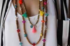 I used brown tone 8-6- 4mm wooden beads ,bright color howlite stone ,silver cz glass beads, 1 cotton tassels,silvertone bell, zirconia charm and cotton cord. The beads sturung on turquoise cord .  Measures;  Long:42 inches  Medium;35 inches  Short:28 inches  You can wear as a necklace set or one,two with another necklaces or you can wrap around your wrist up to 4-5-6 times  PRİCE İS FOR 3 NECKLACES  This necklace set is ready to send today. Please except the items with in 15 to 20 business…