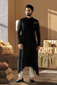 BLACK COWL KURTA Fuse some fun into your traditional wear with this indo-fusion kurta made with hosiery for the perfect fit. The black cowl kurta with drape is sure to make a mark in your style statements. Mens Indian Wear, Mens Ethnic Wear, Indian Men Fashion, Mens Fashion Suits, Wedding Kurta For Men, Wedding Dresses Men Indian, Wedding Dress Men, Wedding Wear, Wedding Suits