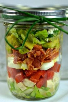 Mason Jar Cobb Salad - 8T. Dressing, 2c. Chopped chicken breast, 2c. Chopped tomato, 4 sliced hard boiled eggs, 2c. Crumbled bacon, 4c. Chopped lettuce, 4T. Crumbled blue cheese