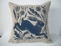 Leaping hare screen printed cushion.From an original lino cut.