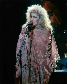 Stevie ~ ღ☆❤☆ღ ~ onstage with big fluffy hair, completely wrapped in her pink and pale floral pink and blue shawl
