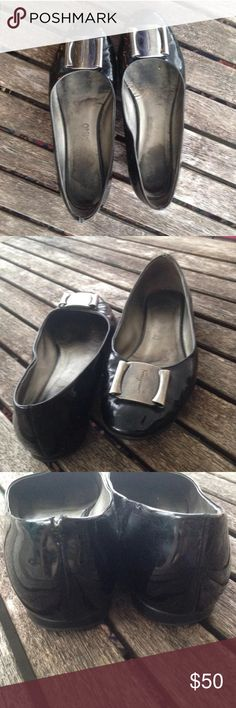 Salvatore Ferragamo Size 8 Buckle Toe Flat Salvatore Ferragamo  • Size 8 • Patent Leather • Signature Buckle • Wear and tear (there is a tear on the back seam of the left shoe-please look at pictures) Salvatore Ferragamo Shoes Flats & Loafers