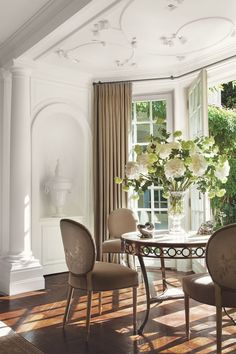 Traditional Dining Room in by Thomas Pheasant Interiors