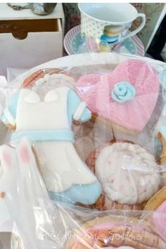 Take a look at this magical Alice in Wonderland baptism! The cookies are so pretty! See more party ideas and share yours at CatchMyParty.com    #catchmyparty #partyideas #aliceinwonderland #aliceinwonderlandparty #baptism #teaparty #cookies