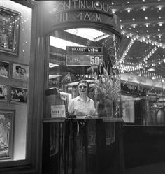 A woman peers out from a ticket booth of a movie theater in New York's Times Square in (Frank Oscar Larson) New York Street, New York City, 42nd Street, Vintage Movie Theater, Theater Tickets, Theater Days, Cinema Ticket, Vintage New York, Street Photographers