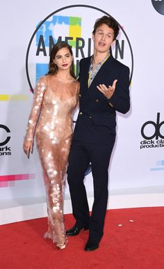 Violetta Komyshan Photos - Violetta Komyshan (L) and Ansel Elgort arrive at the 2017 American Music Awards on November 19, 2017, in Los Angeles, California. / AFP PHOTO / Mark Ralston - 2017 American Music Awards - Arrivals