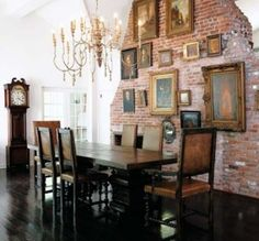 Oil paintings on a brick wall- so old world and fresh at the same time (white walls keep it looking fresh and current)