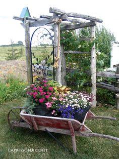 Rustic arbor with metal trellis sides at http://empressofdirt.net/garden-arbor-ideas/