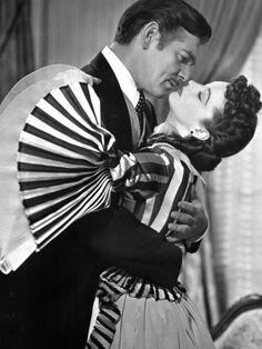 Set against a backdrop of the Civil War and the South's period of reconstruction, Gone With the Wind brought Margaret Mitchell's famous novel about Scarlett O'Hara, Rhett Butler, and the plantation called Tara to the silver screen.  Starring: Clark Gable, Vivien Leigh, Thomas Mitchell  Released: 1939