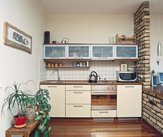 A small kitchen forces you to be minimalist, and it's surprisingly efficient to cook in one.