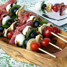 Antipasto Skewers - I tried this with a bocconcini mozzarella salad, layered cherry tomato, basil leaf, bocconcini..etc on a skewer and drizzled with a balsamic glaze.