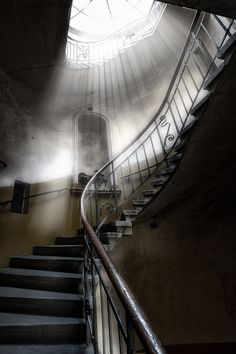 Love the way the light shines down on this old staircase, great photo