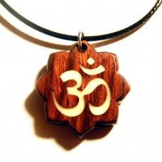 OM (or AUM) is the syllable you may have been chanting in yoga class. It is considered to be the most sacred universal mantra. This pendant, with the OM symbol cut into the centre of the lotus flower background, is beautiful in its simplicity and power.  This piece is handcrafted from Chechen wood.#chechen #wood #aum #om #yoga #pendant #unique #handcrafted #handmade #yogini #yogi #glow #inthedark Om Symbol, Syllable, Flower Backgrounds, Lotus Flower, Mantra, Meditation, Glow, Wanderlust, Symbols