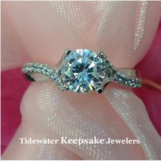 Smooth lines compliment the rows of diamonds in this twist engagement ring. Tidewater Keepsake Jewelers