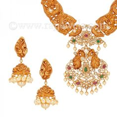 Peacock Diamond Gheru Necklace   #Peacock design #necklace and matching dangle earrings (3 piece set) in 22 karat yellow #gold with #gheru finish, studded with uncut diamonds (10.29 carats), ruby, emerald and south sea pearl. T - See more at: https://www.rajjewels.com/22-k-gold-gems-pendant-diamond-choker-earring-s.html#sthash.twuuVl3K.dpuf