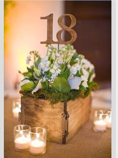 Vintage centerpiece: wooden box, succulents, and candles