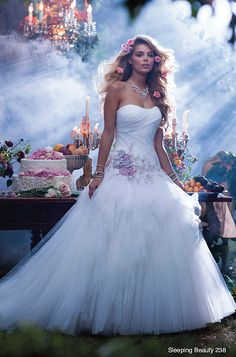 "This Alfred Angelo ""Sleeping Beauty"" gown ($1,249) has pink floral detailing on the bodice reminiscent of Aurora's gown."