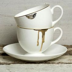 """teacups with gold """"stains"""""""