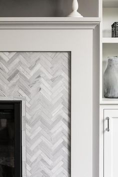 Marble herringbone fireplace tiles
