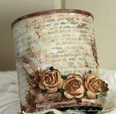 Recycled Can covered beautifully in book page, pretty paper, old ephemera.