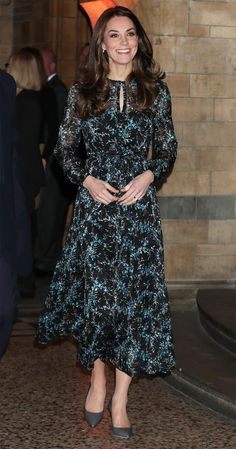 Middleton stepped out at the Natural History Museum in a black and blue printed L.K. Bennett dress and pointy pumps. She paired the floral frock with her signature wavy blowout and drop earrings.
