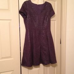 Banana Republic Size 12 Dress Purple Banana Republic Dress in size 12. Fitted and zips in the back. It has pockets as well. Never worn because it was too small for me. Banana Republic Dresses