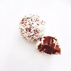 Coconut & raspberry. Organic, handmade fresh cream chocolate truffle.