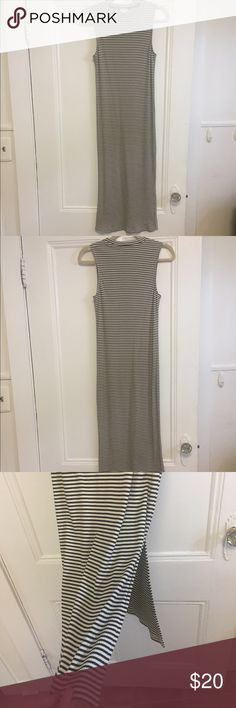 "Midi Striped Bodycon Dress GARAGE bodycon dress. Ribbed, with black and white stripes. Midi length. I'm about 5'8"" and the hem hits at about mid-shin. Slit on side comes up to my knee. Very form fitting but flattering. Worn one time. Perfect condition. Garage Dresses Midi"