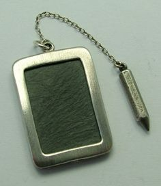 large 1970s English silver slate charm with a miniature pencil, perfect for writing messages and a really UNUSUAL charm - sold for 34gbp