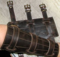 Pair of chocolate brown leather shin guards or gaiters. Description from etsy.com. I searched for this on bing.com/images