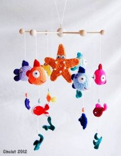 Fish Baby Mobile - luv the crochet! Crochet Baby Mobiles, Crochet Mobile, Crochet Toys, Craft Patterns, Baby Patterns, Crochet Patterns, Crochet Fish, Crochet Flowers, Fish Mobile