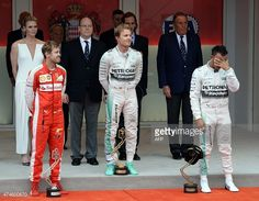 Winner Mercedes AMG Petronas F1 Team's German driver Nico Rosberg, second-placed Scuderia Ferrari's German driver Sebastian Vettel and third-placed Mercedes AMG Petronas F1 Team's British driver Lewis Hamilton stand on the podium with Princess Charlene of Monaco and Prince Albert II of Monaco and his nephew Andrea Casiraghi after the Monaco Formula One Grand Prix on May 24 at the Monaco street circuit in Monte-Carlo. AFP PHOTO / BORIS HORVAT