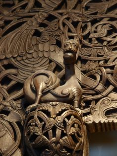 Carved door of a stave church in Oslo, Norway. (Mararie)