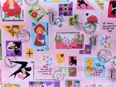 Kokka Japanese fabrics November Books Fairy Tales Stamps by Push Pin in pink (Half Yard)