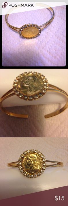 Gold plated bracelet Gold plated bracelet with a coin looking face design! Thanks I'm a smoker Jewelry Bracelets