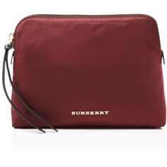 Burberry Large Nylon Pouch ($195) ❤ liked on Polyvore featuring beauty products, beauty accessories, bags & cases, burgundy red, cosmetic bag, make up bag, travel bag, make up purse and toiletry bag