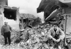 Two Bosnian Muslims, father and son, in the ruins of their house in Sarajevo after it was destroyed by a Serbian missile, June 1992. The young man's wife was killed in the explosion.