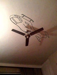 A helicopter on the ceiling over the fan...a ceiling is still a wall!