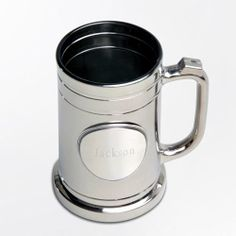 Pewter Medallion Gunmetal Mug made of glass that is coated with a thin, shiny metal finish. The front of the glass has a pewter medallion that is available plain or with a banner on the bottom that can read Usher, Groom, Best Man, or Groomsman. It can hold up to 16 ounces of your favorite beverage.